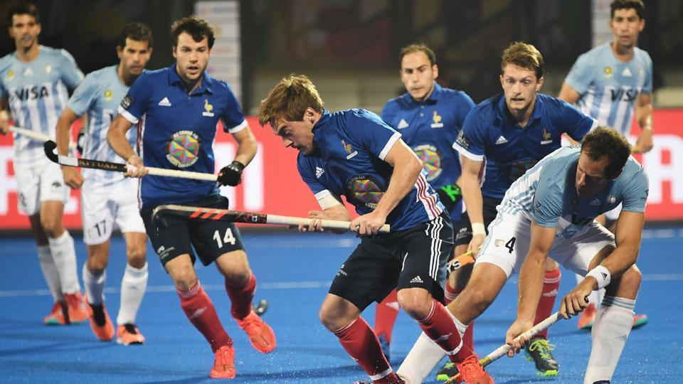France's Hugo Genestet(C) is challenged by Argentina's Juan Gilardi (2R) during the field hockey group stage match between France and Argentina at the 2018 Hockey World Cup in Bhubaneswar on December 6, 2018.