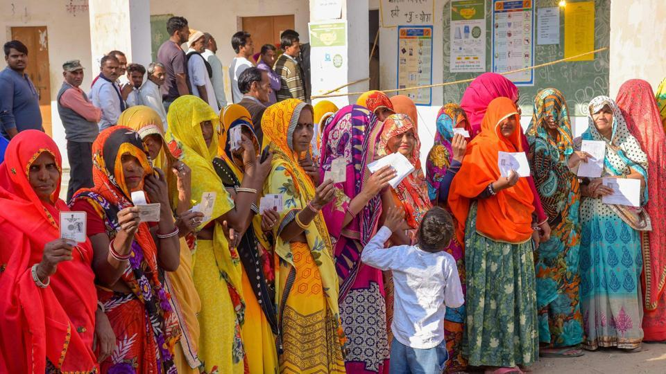 Rajasthan assembly elections 2018: Voters show their identity cards as they wait in queues at a polling station to cast their votes for state Assembly elections, in Jaipur, Friday.