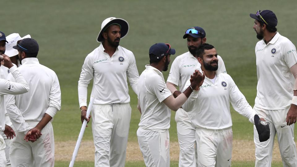 Indian players celebrate after winning the Adelaide Test againstAustralia.