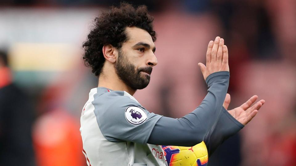 Liverpool's Mohamed Salah applauds fans after the match.