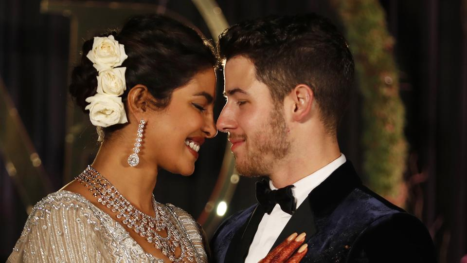 Priyanka Chopra and musician Nick Jonas pose for photographs at their wedding reception in New Delhi.