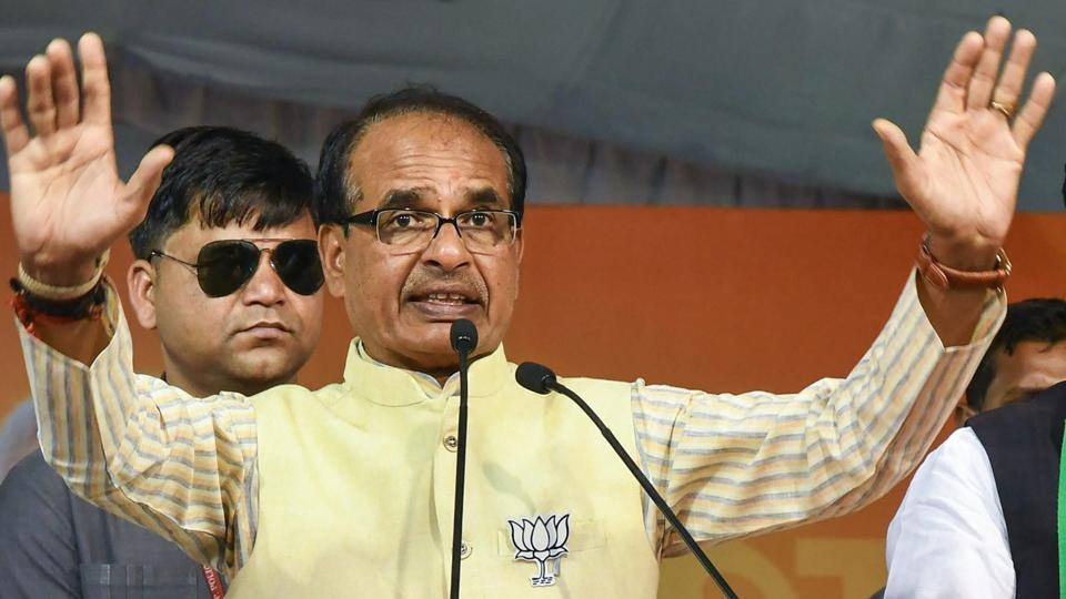 Madhya Pradesh chief minister Shivraj Singh Chouhan campaigns in support of BJP candidate Rameshwar Sharma, in Bhopal on Nov 26.