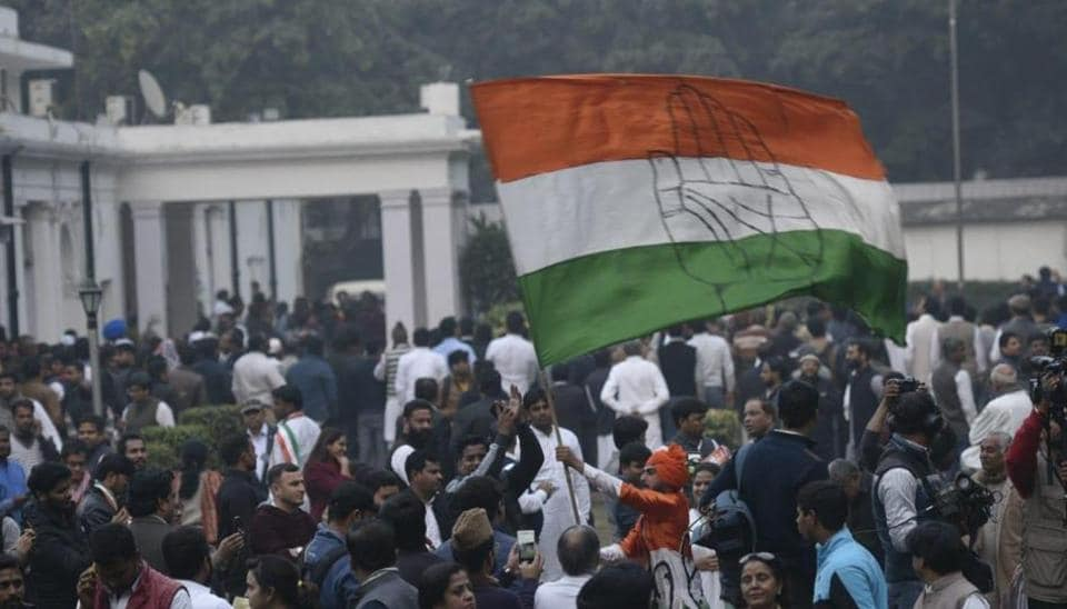 Supporters wave the Congress party flag on their victory at party's headquarter in Delhi on 11 Dec 2018.