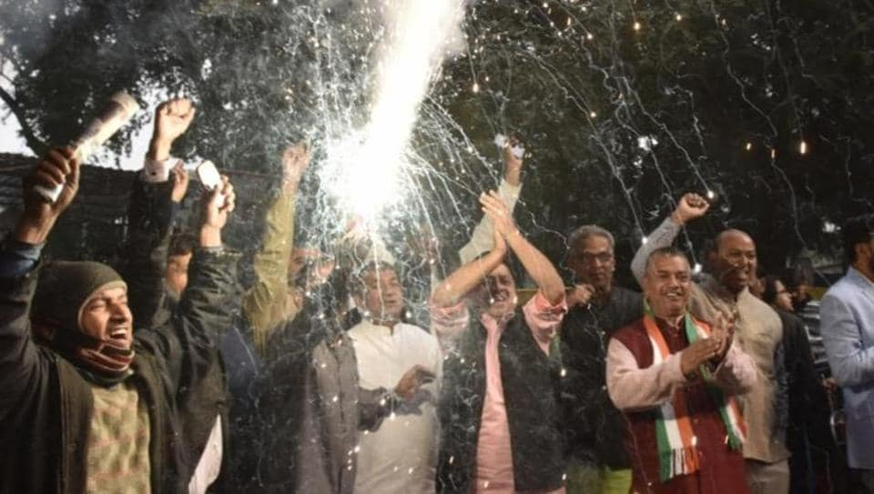 Congress party workers celebration after congress gets lead in state elections at AICC.