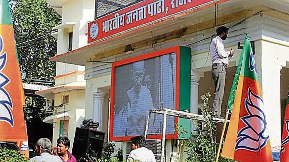 Workers put up sound systems and digital screen at the BJP office in Jaipur on the eve of counting of votes
