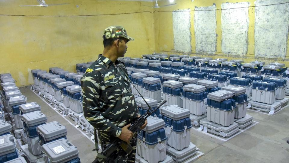 A para-military jawan guards EVMs (Electronic Voting Machines) at a counting centre in Jaipur on Tuesday.