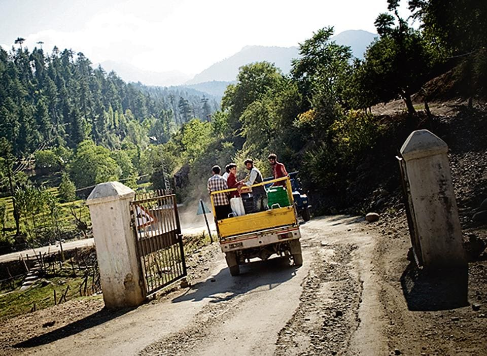 A truck drives through the Line of Control, which is a two mile-wide no man's land at the border between India and Pakistan.