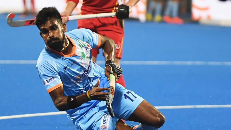 India's Sumit (C) tries to dribble past Belgium's Tom Boon during the field hockey group stage match between India and Belgium at the 2018 Hockey World in Bhubaneswar.