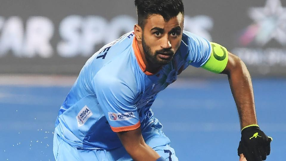 India's captain Manpreet Singh controls the ball against Canada during the field hockey group stage match between India and Canada at the 2018 Hockey World Cup in Bhubaneswar.