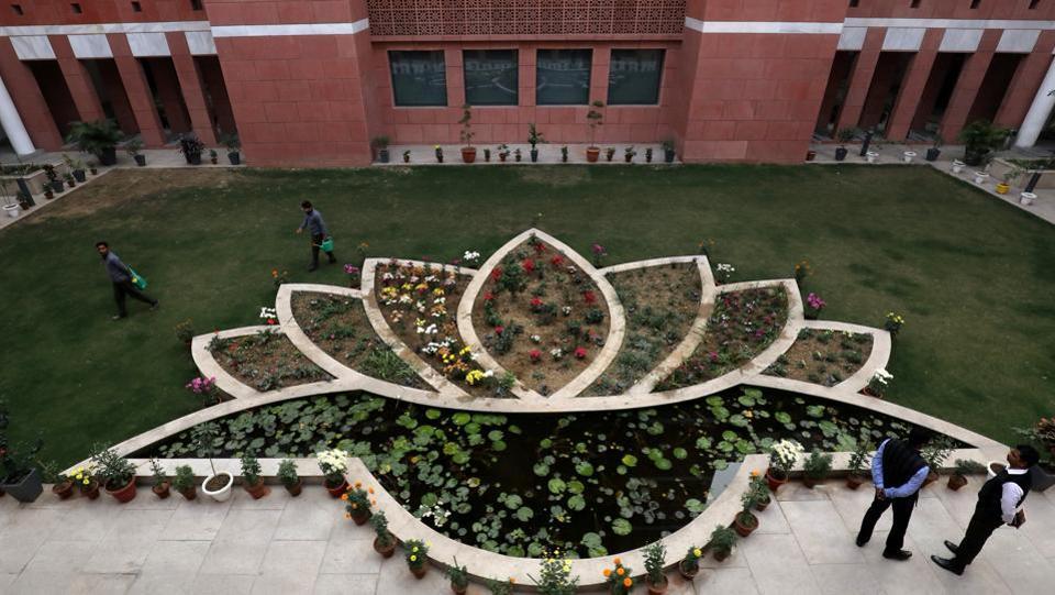 People walk inside the premises of India's ruling Bharatiya Janata Party (BJP) headquarters in New Delhi.