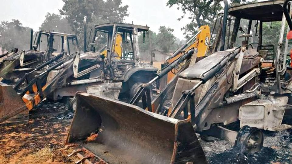 Vehicles that were set on fire by Maoists in the Saryu area in Latehar district on Monday.