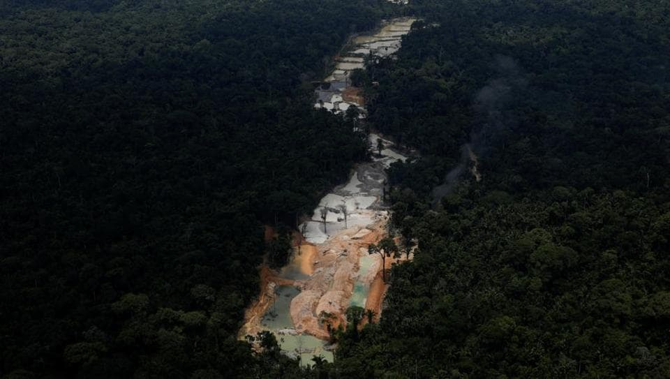 An illegal cassiterite mine is seen in national parks near Novo Progresso, southeast of Para state, Brazil. Environmental enforcement agents deep in the Amazon, swooped down on an illegal mine in a dawn raid in early November, in a campaign to tamp down on such activities that environmental groups say have reached epidemic scale. (Ricardo Moraes / REUTERS)