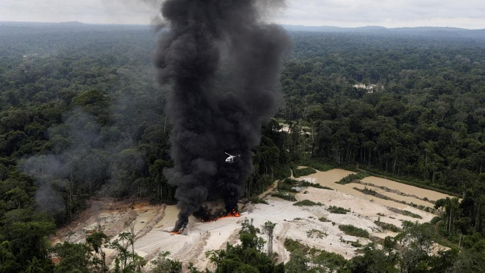 Ibama said its primary target is the excavators and other heavy machinery that is expensive and harder to replace. Unable to haul away the machines, the agents set fire to them, sending black plumes of smoke hundreds of feet into the air. (Ricardo Moraes / REUTERS)