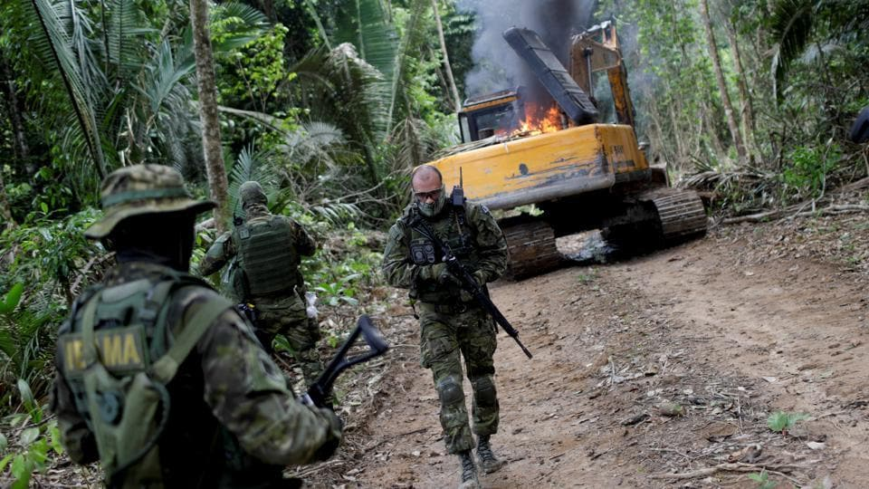 Shortly after, half a dozen were apprehended for questioning by camouflaged agents bearing machine guns. The project, coordinated by Brazilian advocacy group Instituto Socioambiental, maps all illegal mines in the Amazon rainforest that sprawls across Brazil, Venezuela, Colombia, Peru, Ecuador and Bolivia.  (Ricardo Moraes / REUTERS)
