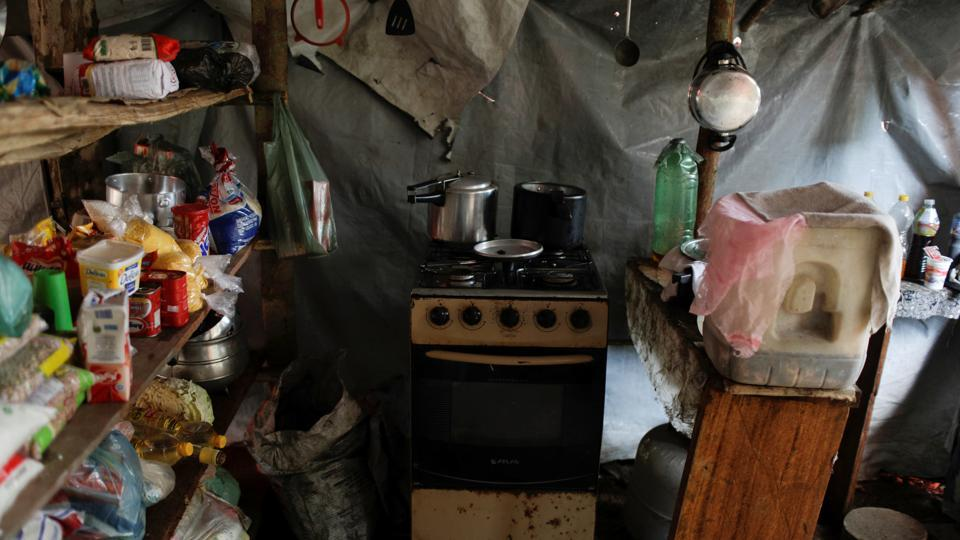 "An improvised kitchen is seen at a miners' camp at an illegal gold mine. The first-ever attempt to map all of the region's illegal mines recorded 2,500 such operations across six Amazon countries, said coordinator Alicia Rolla. One aim of the project is to call attention to the ""epidemic"" scale of illegal mining, which pollutes local communities' water with mercury and contributes to deforestation. (Ricardo Moraes / REUTERS)"