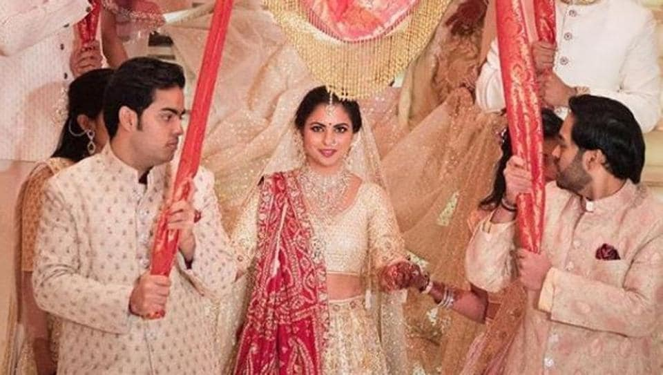 Isha Ambani at her wedding with brothers Ananth and Akash Ambani.