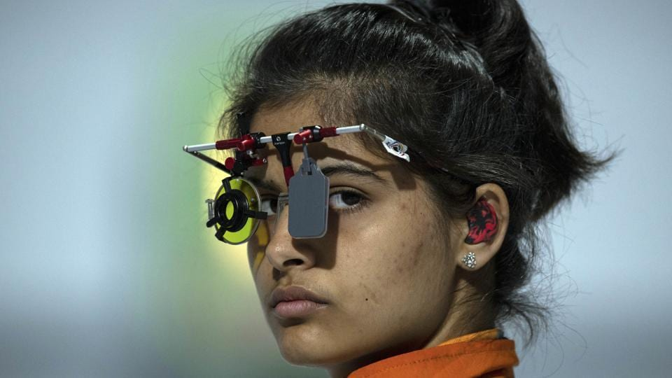 In this photo provided by the OIS/IOC, Manu Bhaker of India competes in the shooting 10m air pistol mixed international team quarter-final , during the Youth Olympic Games in Buenos Aires, Argentina.