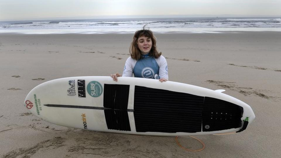 Lopez takes a break from surfing. Visually impaired surfers such as Lopez' countryman Aitor Francesena or Brazilian Derek Rabelo have achieved legendary status in the sport, and Lopez, who only took up surfing a few months ago, is aiming high. (Eloy Alonso / REUTERS)