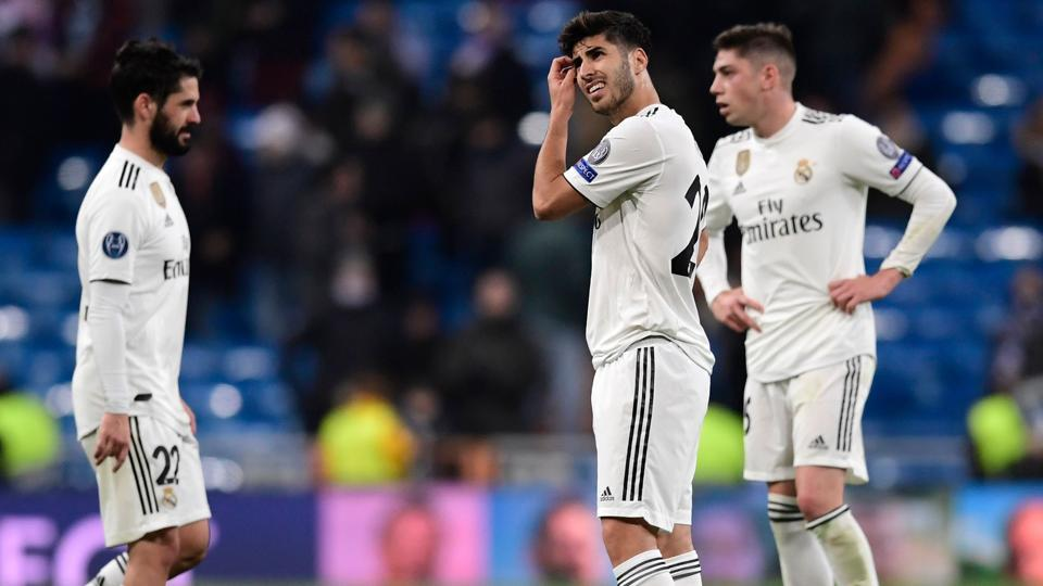 Real Madrid's Spanish midfielder Marco Asensio (C) gestures during the UEFA Champions League group G football match between Real Madrid CF and CSKA Moscow at the Santiago Bernabeu stadium.