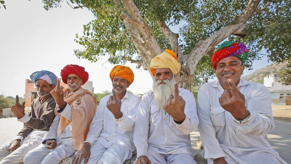 Voters after casting their vote in village Padampura, near Ajmer, India, Friday, Dec. 7, 2018.