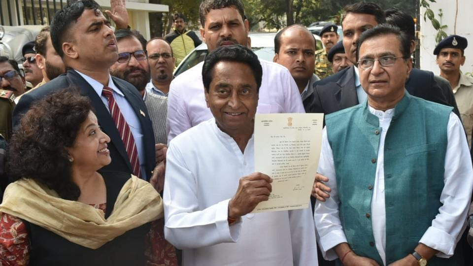 Senior Congress leader Kamal Nath shows Madhya Pradesh Governor Anandiben Patel's letter inviting him to form the government in the state, outside Raj Bhawan in Bhopal. Kamal Nath will lead the Congress government in Madhya Pradesh where it returned to power after 15 years, the party announced after a meeting of its legislators in Bhopal.