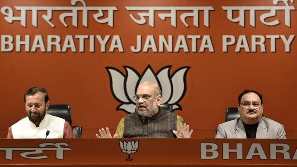 "BJP President Amit Shah addresses a press conference at the party's headquarters in New Delhi. ""Rahul Gandhi should apologise that he tried to create suspicions in the mind of the soldiers and people... He has attempted to jeopardise the nation's security,"" Shah said, launching into a stinging attack on Gandhi and the Congress after the Supreme Court's clean chit to the government on the Rafale aircraft deal. (Sanchit Khanna / HT Photo)"