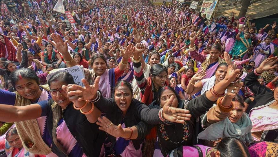 Accredited Social Health Activist (ASHA) workers during a protest demanding a hike in their wages and the regularization of their jobs, in Patna. ASHA workers have been on a state-wide indefinite strike since December 01, 2018. (PTI)