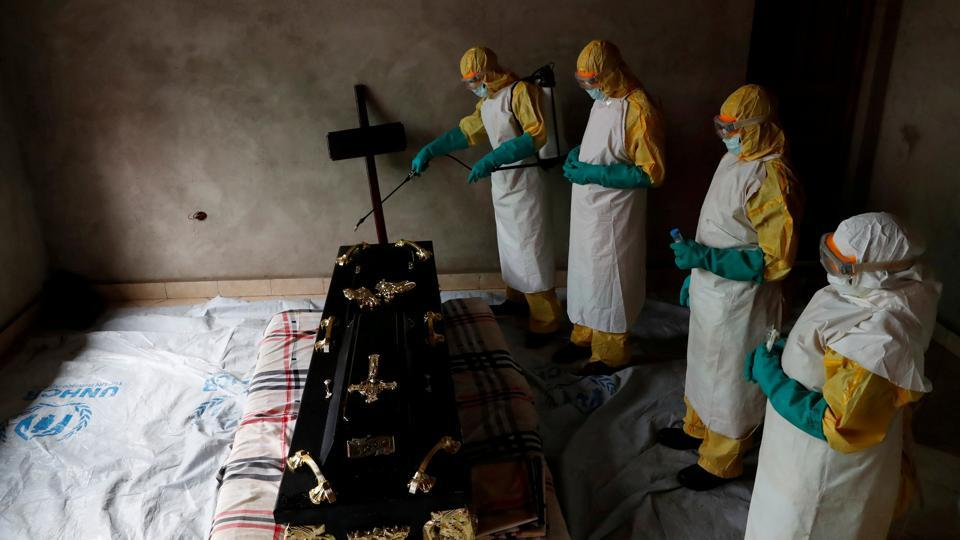 A healthcare worker sprays a room during a funeral of Kavugho Cindi Dorcas who is suspected of dying of Ebola in Beni, North Kivu Province of Democratic Republic of Congo. (Goran Tomasevic / REUTERS)