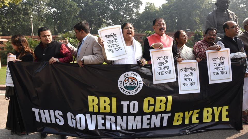Trinamool Congress MPs raise slogans and display placards while staging a protest against the Union government and its 'misuse' of central institutions like the RBI and CBI, during the Winter Session of Parliament, in New Delhi. (Arvind Yadav / HT Photo)
