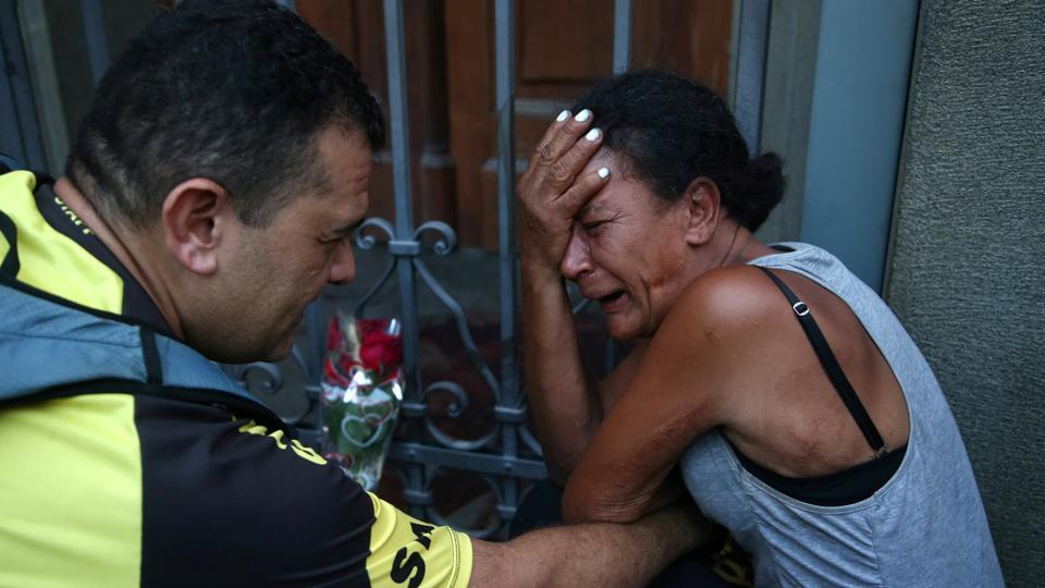 People react after a shooting at Catholic cathedral in Campinas, Brazil. (Amanda Perobelli / REUTERS)
