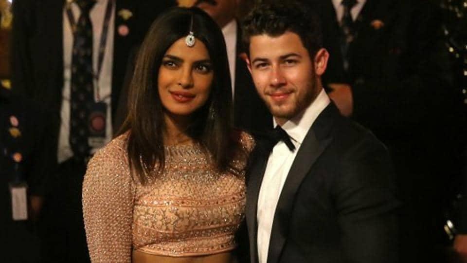 Actress Priyanka Chopra and her husband Nick Jonas arrive to attend the wedding ceremony of Isha Ambani.