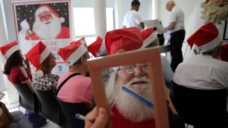 A students at Santa Claus school takes a quick grooming break during a class in Sao Paulo, Brazil. (Paulo Whitaker / REUTERS)