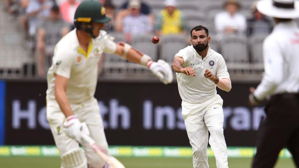 India's Mohammed Shami (C) attempts to run out Australian batsman Pat Cummins (L). (AFP)