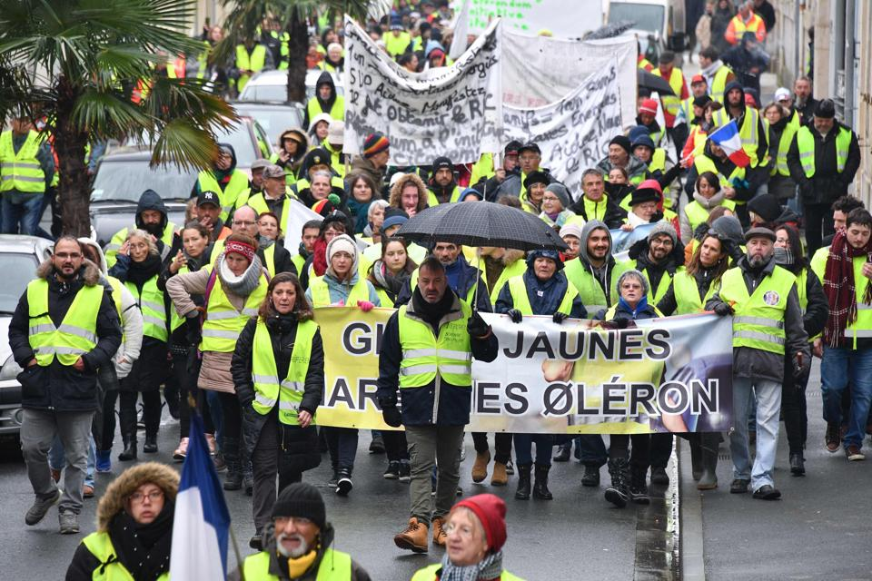 Protesters wearing Yellow Vests (Gilets jaunes) demonstrate against rising costs of living blamed on high taxes in Rochefort, south-western France on December 15.