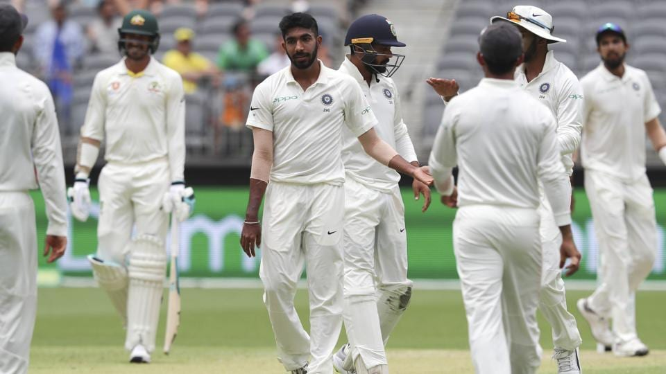 India's Jasprit Bumrah (3rd left) is congratulated by teammates after bowling Australia's Tim Paine. (AP)