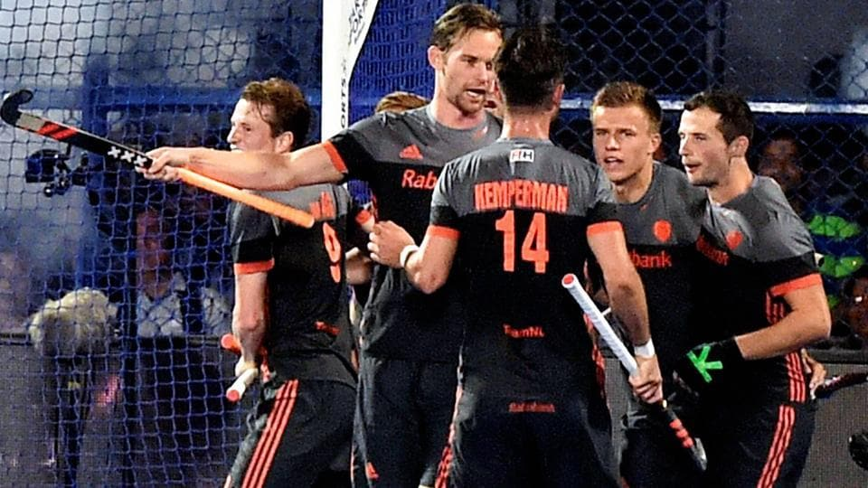 Netherlands players celebrate after scoring a goal against Australia.