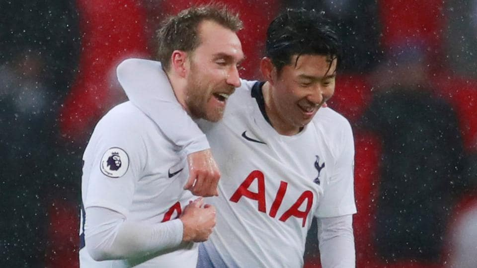 Tottenham's Christian Eriksen celebrates with Son Heung-min at the end of the match.