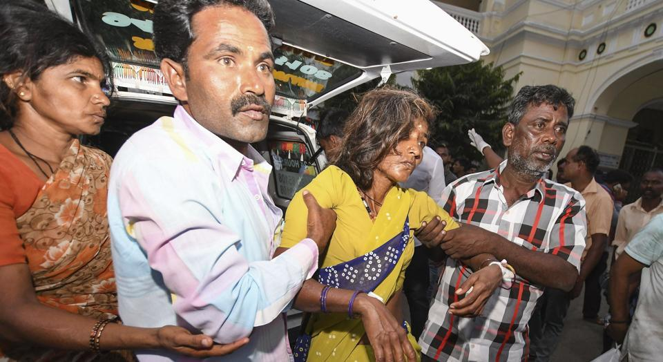 A woman is shifted to a hospital in as she complained of sickness after consuming 'prasad' at Maramma temple in Chamrajanagar district, in Mysuru on Friday, December 14, 2018.