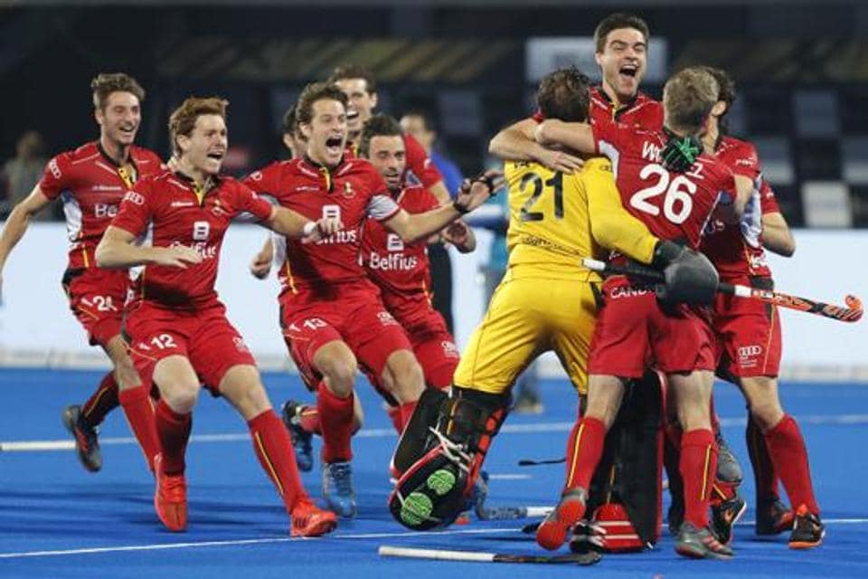 Belgium players celebrate their win over Netherlands in the Men's Hockey World Cup finals at Kalinga Stadium in Bhubaneswar, India.