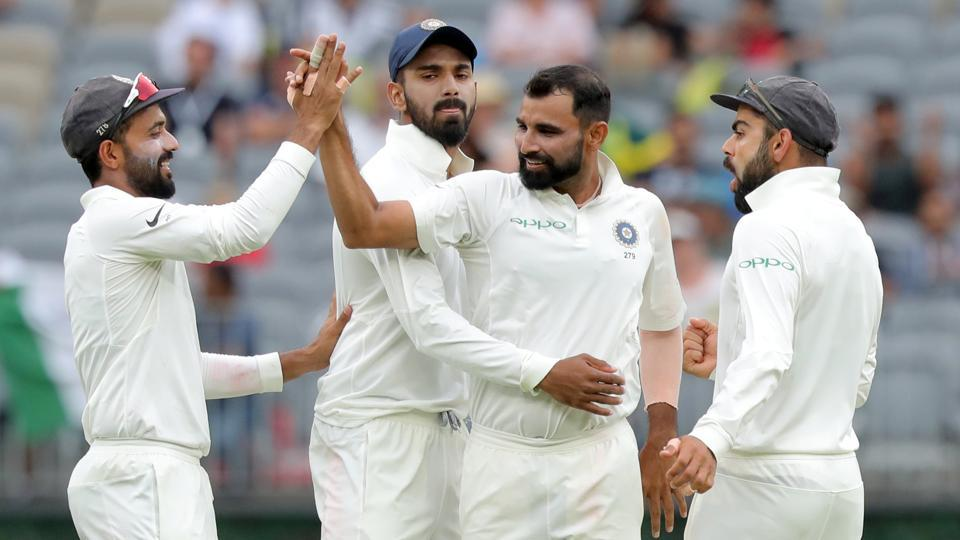 India's Mohammed Shami is congratulated by his teammates after dismissing Australia's Shaun Marsh on day three of the second test match between Australia and India at Perth Stadium. (REUTERS)