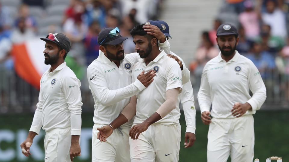 India's Jasprit Bumrah, centre, is congratulated by teammate India's Murali Vijay after claiming the wicket of Australia's Marcus Harris during play in the second cricket test. (AP)
