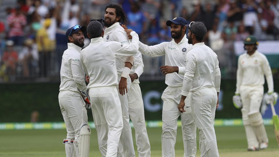 India's Ishant Sharma, third left, is swamped by teammates after he claimed the wicket of Australia's Peter Handscomb. (AP)
