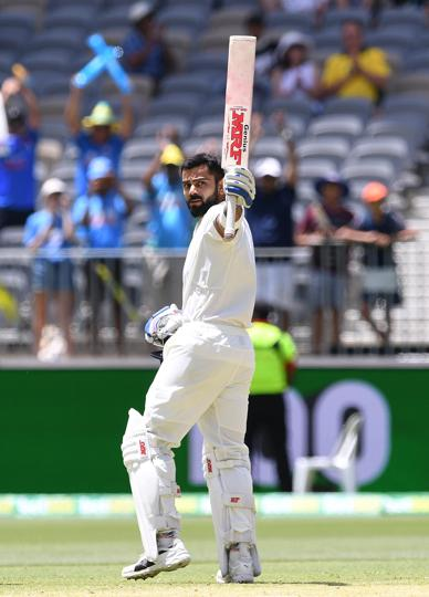 India's captain Virat Kohli reacts after scoring his century on day three of the second test match between Australia and India at Perth Stadium in Perth, Australia. (REUTERS)