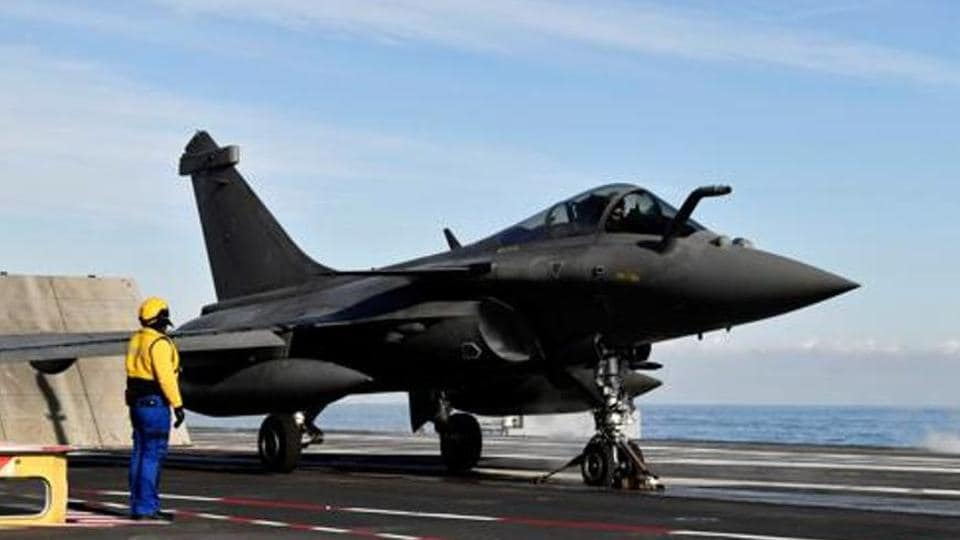 A French fighter jet Rafale prepares to take off on the aircraft carrier.