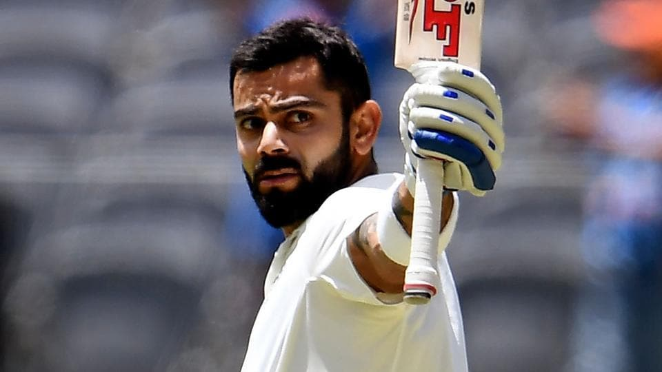 India's batsman Virat Kohli celebrates after scoring his century against Australia on the third day of the second Test match in Perth.