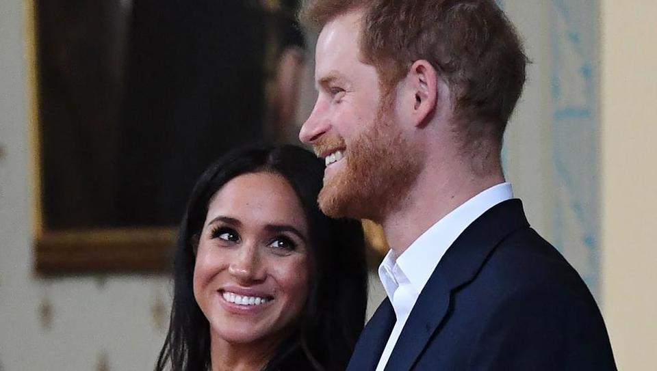 Britain's Prince Harry and Meghan Markle attend a reception at Government House in Melbourne, Australia.