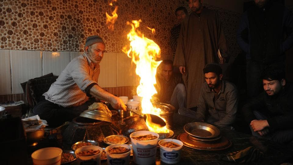 Muhammad Shafi Bhat, a Kashmiri cook, tempers servings of Harissa for his customers in Srinagar, Jammu and Kashmir. Cooked in the winter months, the Harissa has come to signify both life and ritual in the entire valley of Kashmir. A few dozen Harissa shops, mainly in old Srinagar, the downtown area, begin a routine that lasts till March. (Waseem Andrabi / HTPhoto)