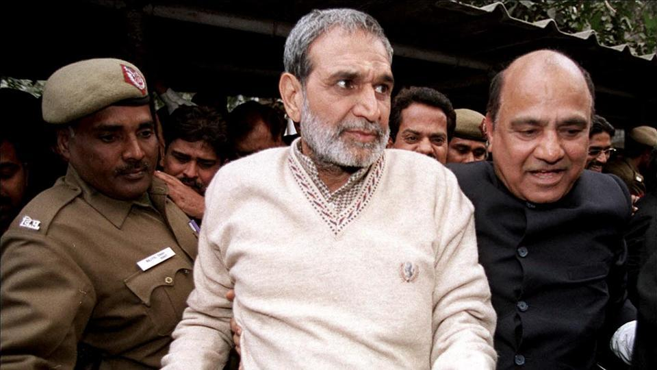 Congress leader Sajjan Kumar leaves Patiala House court in New Delhi.