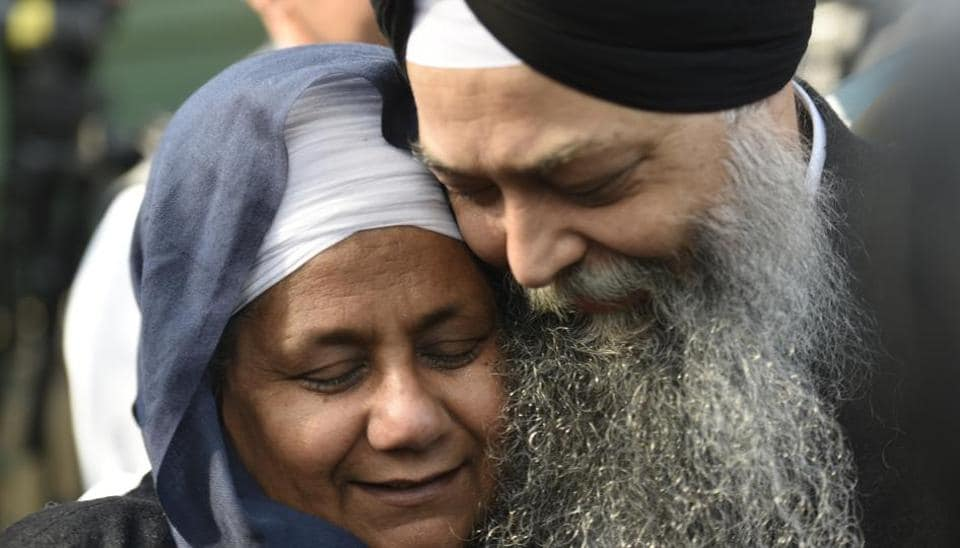 Nirpreet Kaur, an eye-witness of the 1984 Sikh massacre, and AAP leader Jarnail Singh rejoice the Delhi High Court judgement sentencing Congress leader Sajjan Kumar to life imprisonment in connection with the massacre, at Delhi High Court, in New Delhi, India, on Monday, December 17, 2018.
