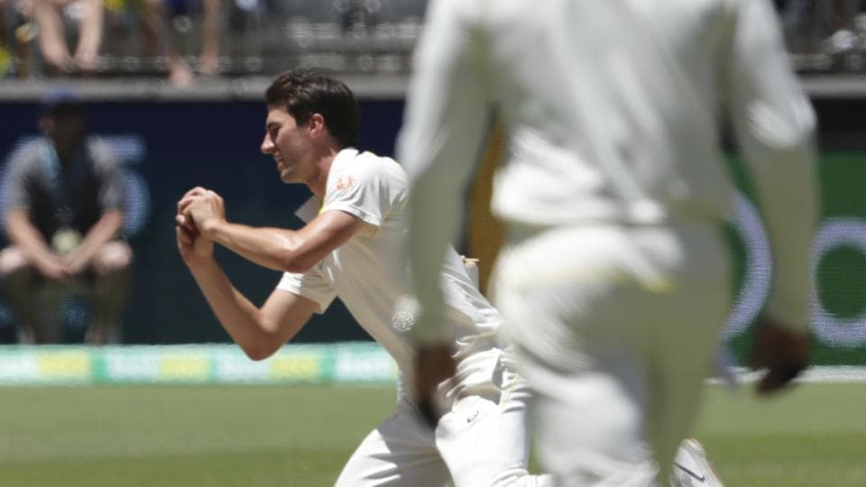 Australia's Pat Cummins takes a catch to dismiss India's Jasprit Bumrah, India's last wicket giving Australia the win the second cricket test in Perth, (AP)